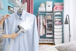 using the clothes steamer to do chores