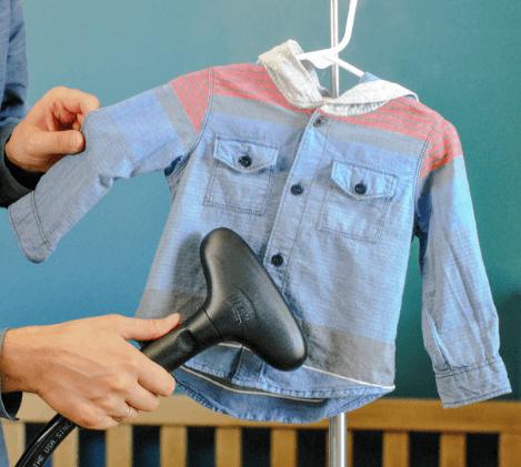 using garment steamer to iron baby shirt